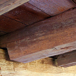 Foundation construction of detached kitchen building showing hand-hewn sill and joists
