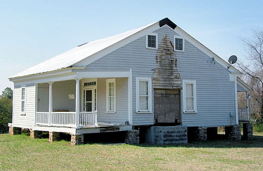 Northeast façade of the main house at Hembree Farm, in the process of rehabilitation